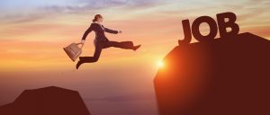 Woman jumping from lower rock to higher rock with word - Job
