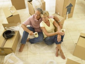 long distance moving companies Lincoln - older couple with moving boxes