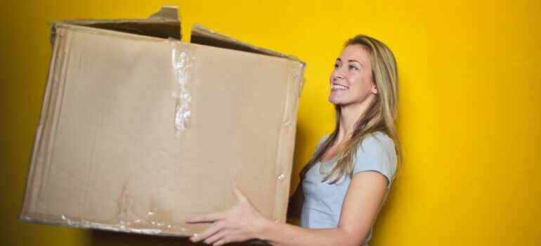 girl with moving box