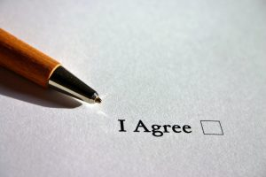 Close up of a pen and a checkbox on a paper