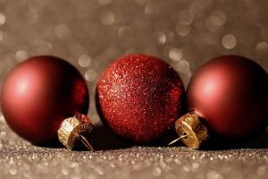 Three red baubles on a table