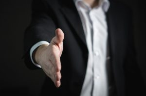 Man extending his hand for a handshake