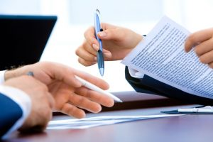 Long distance moving companies Aberdeen signing contracts with you