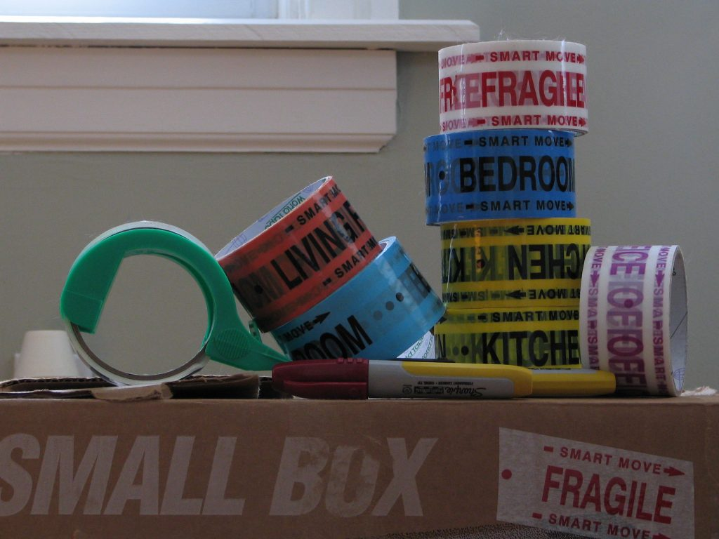 Packing tape and a box