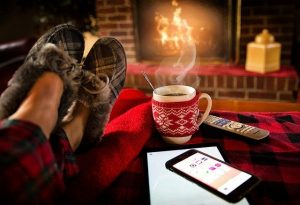 Cosy slippers, fireplace, coffee mug, phone