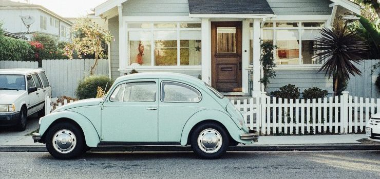 a Volkswagen beetle in front of a house