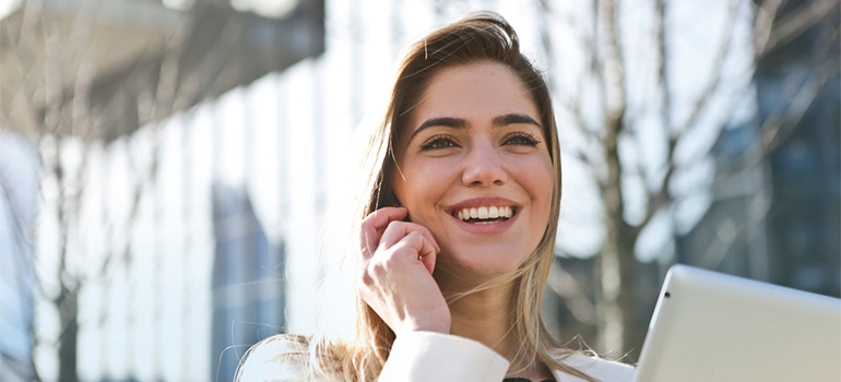 A girl on the phone smiling