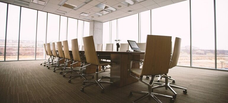 A conference room with a table and chairs