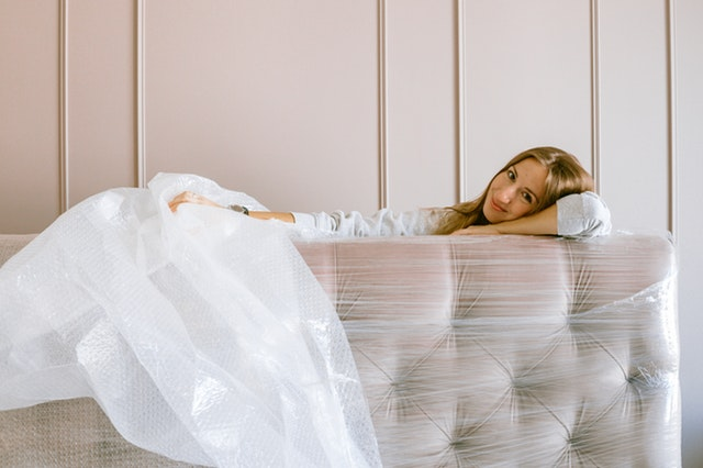 Woman smiling while packing for the move