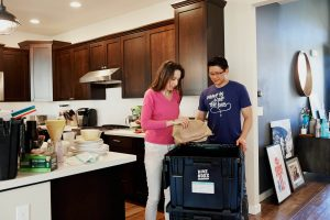 Man and woman packing for a move