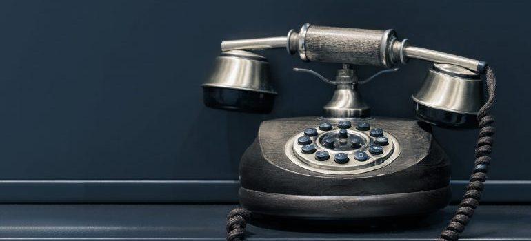 A black rotary dial phone