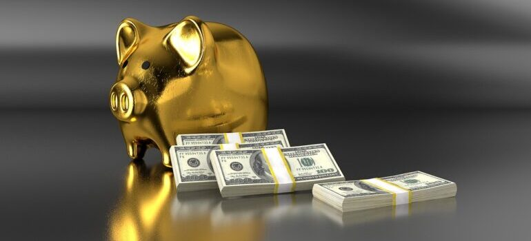 A golden piggy bank with stacks of dollars