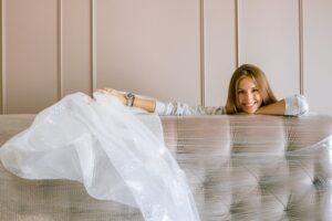 A woman with bubble unwrapping her bed