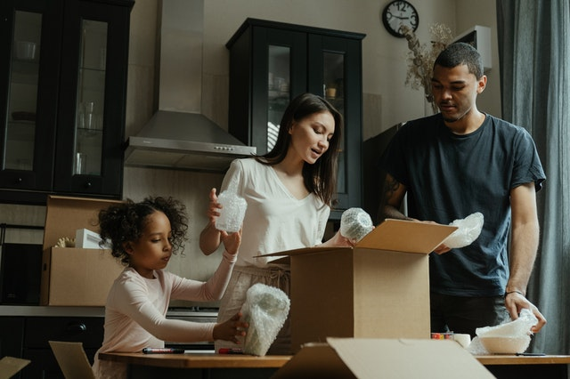 Family packing for the move after learning why do Americans move so much more than Europeans