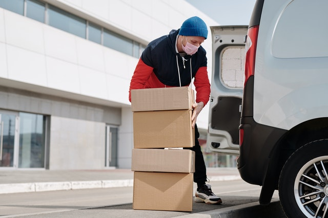 Mover putting boxes in the van