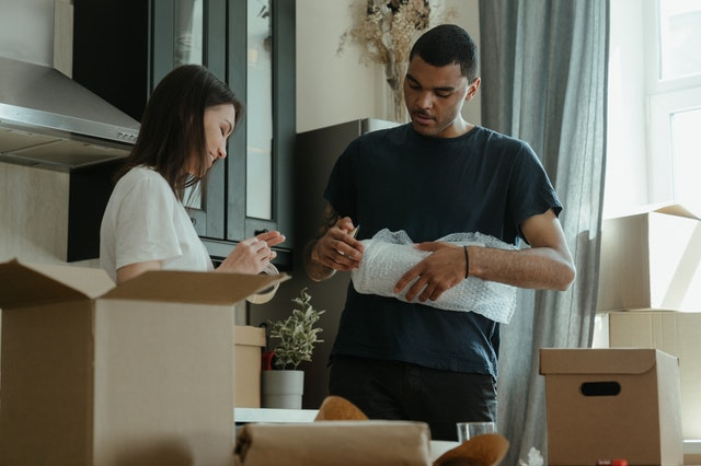 A man and a woman packing