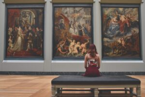 -a woman looking at fine arts