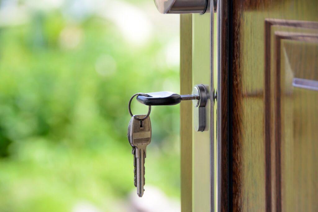 metal key in a wooden door