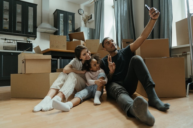 Family taking photos before moving from Philadelphia to Boston