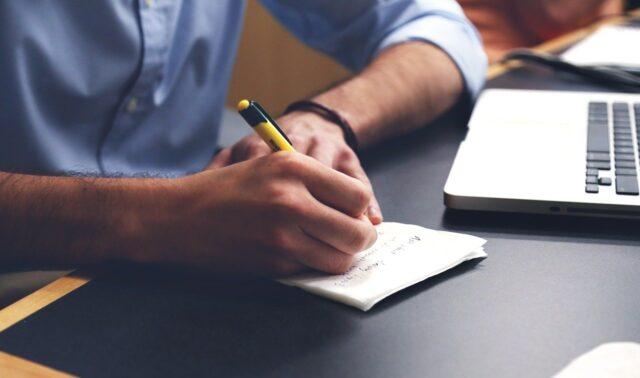 man writing down a plan