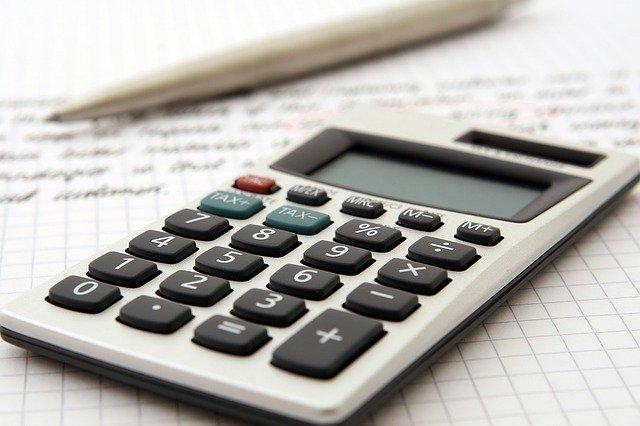 a calculator and a pen
