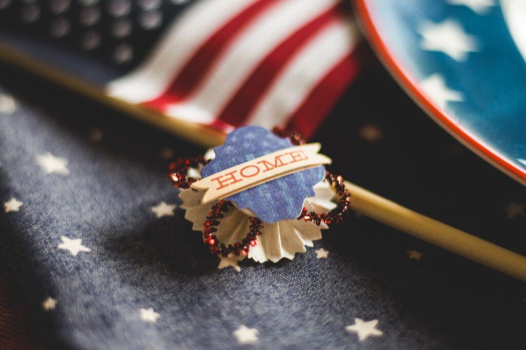 American flag and an ornament with the word 'home' on it