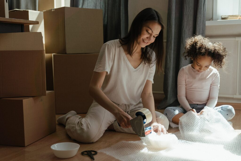 Mother and daughter packing for a move