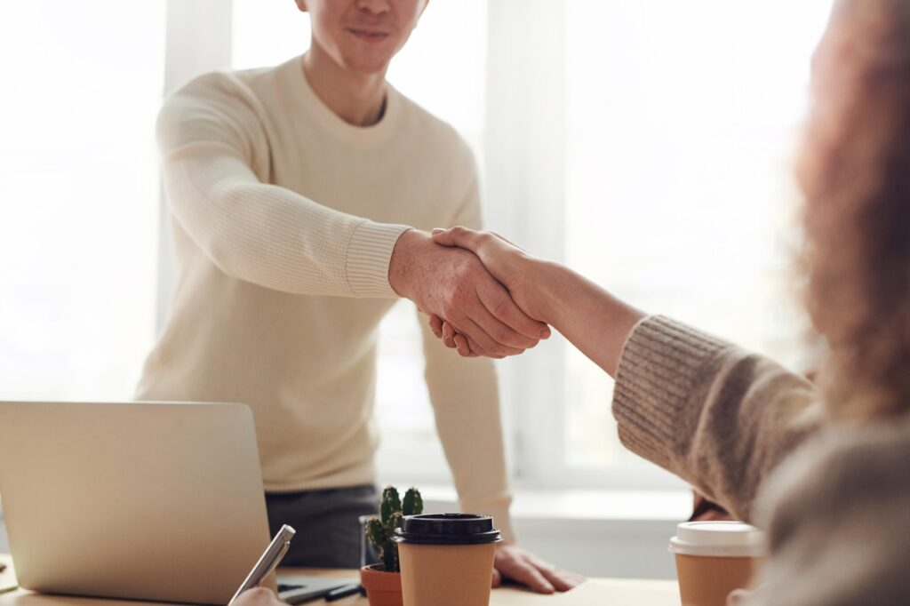 A man shaking hands with a woman