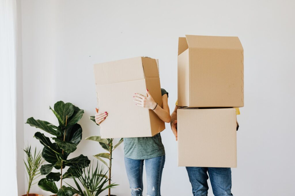 peope with moving boxes for Moving from Indiana to Michigan