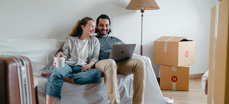 a couple checking their moving checklist before moving out of state