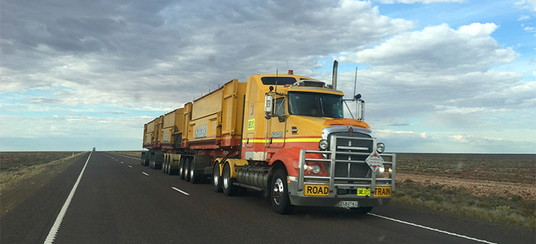 A yellow moving truck