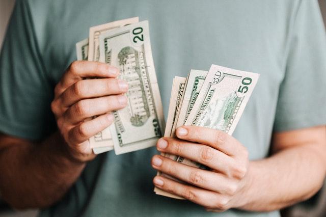 A man holding dollar bills