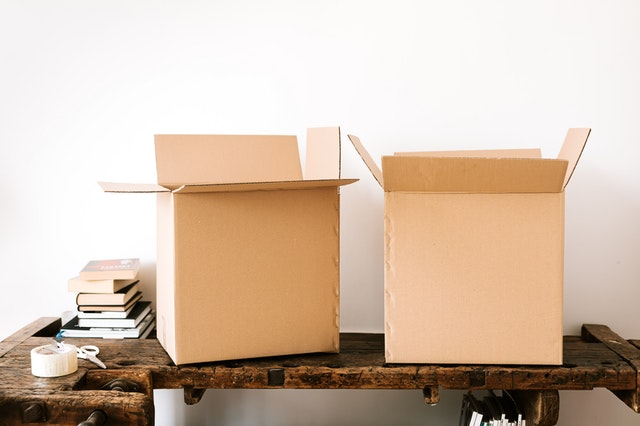 Cardboard boxes sitting on atable
