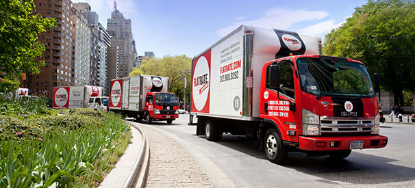 flatrate moving company's trucks on the road