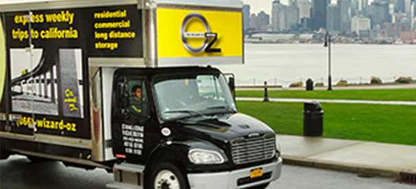 Oz Moving and Storage company truck on the road