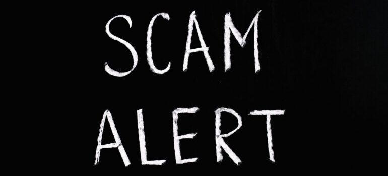 scam alert on a black backgrpund