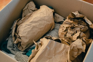 Box with objects wrapped in brown paper