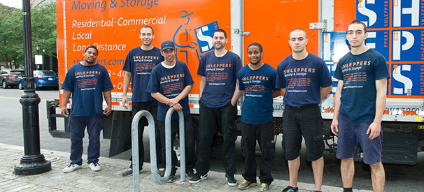 shleppers moving & storage company crew in front of their truck