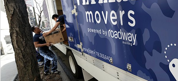 veteran movers crew loading the comapny's moving truck