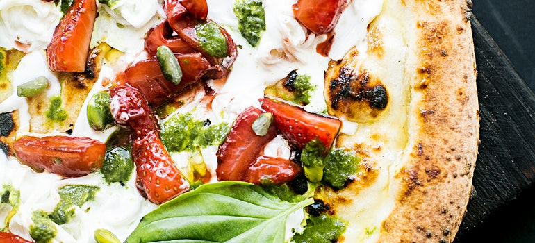 Tasty pizza with basil leaves