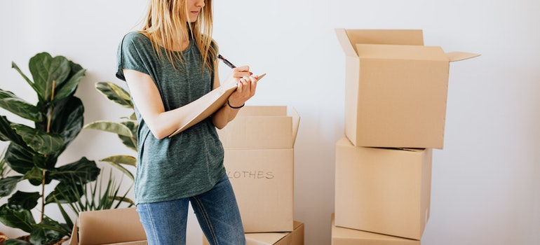 Woman writing while packing