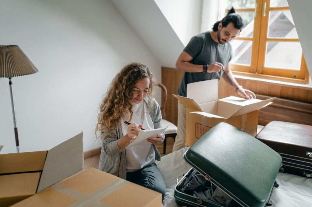 a couple packing their bedroom together before moving from Los Angeles to Austin TX