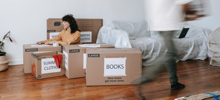 Couple packing between boxes