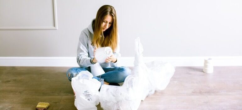 Girl packing while sitting on the floor