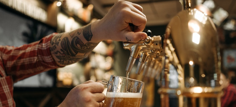 Man pouring beer in beer glass