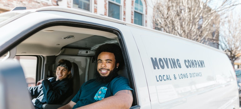 Two guys in a moving truck