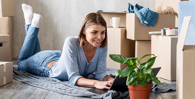 A woman browsing through Verified Movers' platform