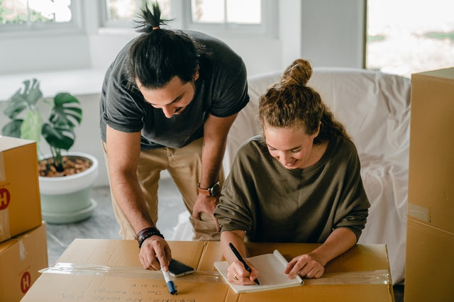 A couple making a checklist for their relocation