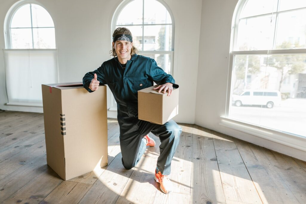 A mover kneeling next to a box