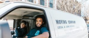 Two guys in moving company van